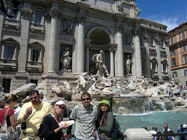 Visitor Throws A Coin Intothe Fountain